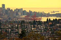 Vancouver City Skyline at Sunset (TOTORORO.RORO) Tags: ocean life travel autumn houses roof light sunset sky canada color reflection building fall tourism nature colors skyline vancouver port reflections lens landscape mirror golden living landscapes downtown cityscape bc view zoom britishcolumbia sony shoreline tourist mount telephoto adapter highrise translucent burrardinlet burnabymountain alpha popular visitor canadaplace viewing dt attractions nationalgeographic amount vancouverharbour nex greatervancouver f4556 mirrorless 55300mm portmetrovancouver laea1 nex6 sal55300