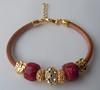 Pulseira Berloques Vermelhos (Ateliê Primavera) Tags: pulseira strass pedraazul berloques pedrarias pulseirasdouradas