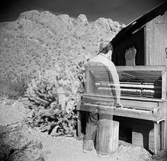 Piano Player (magnetic_red) Tags: mountains southwest tlr desert lasvegas doubleexposure ghost piano player american infrared ghosttown phantom yashicad caffenol eldoradocanyon rolleiir400