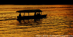 Boat ride (Ok More Photos) Tags: light sunset shadow seascape flores colors backlight landscape atardecer lights boat barco shadows sundown guatemala paisaje backlit paysage backlighting coucherdesoleil lancha waterscape