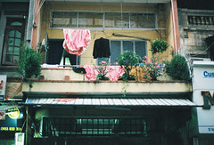 Pink Bedsheets (common sayings) Tags: city travel urban film 35mm canon asia vietnam backpacking chi ho southeast minh saigon