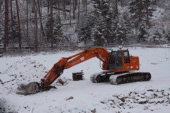 Hoe in Snow (LongInt57) Tags: trees winter red orange brown white snow canada cold green forest work site bucket construction bc arm digging okanagan tracks machine boom machinery pines heavy backhoe digger treads