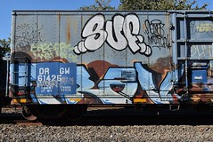 SUF TRAV (TheGraffitiHunters) Tags: graffiti graff spray paint street art colorful freight train tracks benching benched suf floater trav boxcar