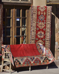 Santa Fe Bench-HBM! (A Political Kind Of Day!) Tags: santafe benchmonday carpets red patterns newmexico usa street store front window doors