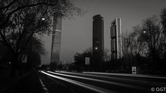La torre escondida (egtenoriodiaz) Tags: canon madrid 18mm longexposure cokin ndfilter sigma 18125mm cheaplens zoomlens wideangle ctba building edificio rascacielos skyscrapper 450d traffic lightroom lights blackandwhite bw blancoynegro