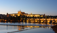 Panorama evening view of Prague Castle and Charles Bridge (Stanislav Zakurdaev) Tags: charlesbridge czechrepublic europe prague praguecastle stanislavzakurdaev vltava autumn beautifulview blue historical holiday landscape oldtown panorama river sky tonight travel trip photostascom