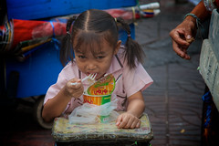 Hungry (Katya_N) Tags: street portrait food girl thailand kid asia child eating bangkok candid noodle