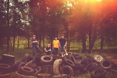 Just boys (Adriana Varela) Tags: boy boys outdoors serious brothers brother tires together pile junkyard scrapyard recycle boyhood