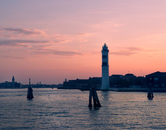 Going home.. (areyarey) Tags: travel venice light sunset sea summer sky italy sun lighthouse tower water lamp silhouette architecture warning island hope dawn twilight italian europe heaven mediterranean ship waterfront dusk landmark security lagoon calm historic beam shore romantic veneti