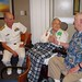 CHARLESTON, S.C. (April 14, 2010) Rear Adm. Bill Goodwin, Assistant Chief of Naval Operations for the Next Generation Enterprise Network (NGEN), shares birthday greetings with World War II Army veteran Josephine, 90, and Navy veteran Hugh Pearson, 75,  at