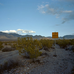 road not maintained. kelso, ca. 2013. (eyetwist) Tags: california road sunset 6 mountains abandoned 120 6x6 mamiya film sign clouds analog mediumformat square landscape 50mm iron mine quiet desert kodak steel empty icon ishootfilm providence dirt faded highdesert mojave medium format lonely vulcan kaiser analogue mamiya6 portra deserted gravel kelso bulletholes mojavedesert maintained emulsion sanbernardinocounty mnp mojavenationalpreserve rutted 160nc primes kodakportra160nc f4l roadnotmaintained providencemountains eyetwist 6mf mamiya6mf theicon kelbaker ishootkodak epsonv750pro recentlyprocessedfilm filmexif filmtagger eyetwistkevinballuff colornegativec41 mamiya50mmf4l