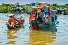 Everything you could ever want and a little more (Tore Thiis Fjeld) Tags: lake water colors shop reflections boat asia cambodia village floating mangrove customer ripples trade merchant merchandising floatingvillage siemriep kampongphluk tonlsap samsungnx210