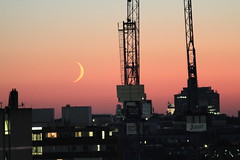 Just Another Evening (Explored 17-12-2013) (hectordotlee) Tags: street old city sunset sky moon london skyline night canon landscape evening crescent cranes waxing cityskyline cityoflondon 500d canon500d waxingcrescent
