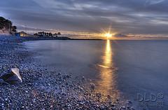 l'alba al Pennello (danilodld) Tags: sea sky italy panorama sun nature landscape italia nuvole mare alba liguria natura sole acqua inverno riflessi hdr paesaggio h20 imperia dld moli 2013 nikond5000