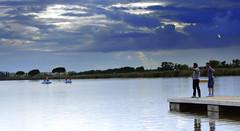 La quiete dopo la tempesta (Michela Vaccaro) Tags: blue summer people lake water rain clouds lago acqua pioggia molo profondit