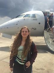 Portrait of Amanda (Kris_wl) Tags: crj900 bombardier psaairlines tarmac nose airport sunny squint outdoors outside solarflair face smile teen girl plane amanda