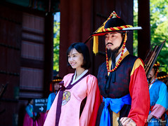 A hanbok lady and her bodyguard (gunman47) Tags: 2016 asia asian city deoksugung hall korea korean october palace rok republic seoul south bodyguard candid ceremony changing costume guard hanbok lady people photography royal smile smiling street traditional woman    southkorea