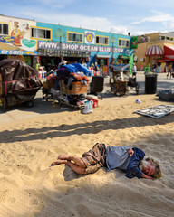 Sun (briantolin) Tags: santamonica california losangeles homeless bum laying sand beach
