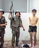 South Vietnamese soldiers show off a Viet Cong prisoner captured near Tan Son Nhut Airbase. May 6, 1968