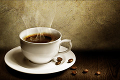 Cup of coffee near press (Hussar Coffee) Tags: life morning brown chart news cup coffee breakfast pen work paper notebook table idea glasses newspaper milk office cafe education keyboard break message drink desk object beverage creative pad lifestyle style business note page pause caffeine press liquid saucer aroma creased