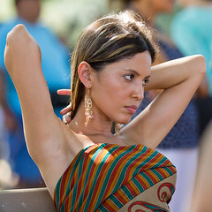 Face in a crowd (coqrico) Tags: woman brown girl face lady female eyes arms crowd rico elbow earrings drooping raised leffanta