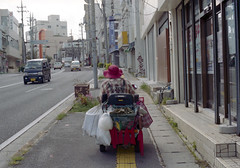 胡屋 シニアカーに乗るひと Okinawa-si, Okinawa (ymtrx79g ( Activity stop)) Tags: street color slr film japan analog nikon kodak 35mmfilm motorcycle okinawa 135 沖縄 kodakgold100 街 写真 銀塩 フィルム nikonnewfm2 沖縄市 自動二輪 nikonainikkor50mmf14 歩行走行 walkandrun 201310blog okinawasi