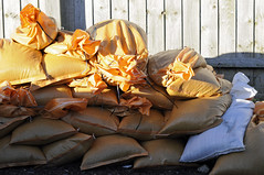 sandbags (dawn.v) Tags: uk winter england orange weather portland whatevertheweather coast seaside nikon january dorset storms floods chesilbeach sandbags flooddefences jurassiccoast 50mmlens winterstorms ukstorm weymouthandportland ukstorms