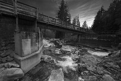 Lynn Canyon Headwaters (Juan Rostworowski) Tags: bridge light sky blackandwhite bw white canada black nature water monochrome beautiful vancouver clouds creek river landscape photography waterfall nikon whitewater stream bc view britishcolumbia wideangle hike rapids trail waterfalls desaturated northvancouver wilderness nikkor yvr lynncanyon hikingtrail headwaters lynnheadwatersregionalpark 1424mm
