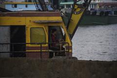 Crane operator (Keith Kelly) Tags: city cruise sunset man water river fun boat asia cambodia seasia southeastasia crane capital phnompenh kh aroundtown mekong workman tonlesap kampuchea craneoperator