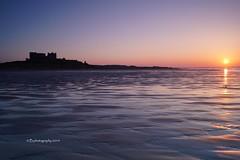Bamburgh Sunset (b photography uk) Tags: sunset sea castle beach silhouette landscape sand northumberland lowtide bamburgh