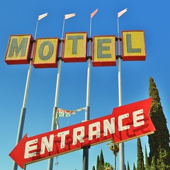 Motel Entrance (rickele) Tags: motel flags palmtrees neonsign arrow centralvalley italiancypress ghostsign highway99 paintedsign vintagesign macfarland famoso ca46 highway46 ca99 plasticsign steelsign famosoinn oldus99 usroute99 castateroute99 castateroute46