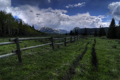 Fenceposts and horse trails (Len Langevin) Tags: alberta canada fence friday hff rockies rockymountains landscape nikon d300s tokina 1224 cloudy day sundre