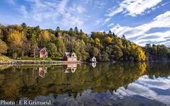 Autumn (2000stargazer) Tags: hordamuseet bergen norway autumn fall reflections fjord water heaven sky clouds trees forest canon landscape seascape shoreline autumncolours