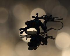 Leapfrog (Ptolemy the Cat) Tags: frog earring silhouette reflection mirror bokeh monochrome jewellery jewelry nikond600 tamronf2890mmmacrolens