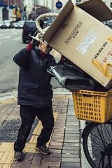 Protest (Chris da Canha) Tags: orange protest president parkgeunhye korea southkorea crowd gwanghwamun gyeongbokgung night city street dongmyo market book books portrait chant fist face faces seoul candle candlelit march demonstration motorbike chipmunk sit wheel chair fur autumn fall