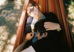 Lovers in the hammock pt. II (Arianna Rubini) Tags: film 35mm canon ftb analog analogue ariannarubini art hammock hug hugging lovers love lovely summer nature portra 400 kodak girl boy portrait young youth couple relationship