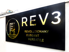 REV3 (Steve Taylor (Photography)) Tags: black gold yellow white contrast sign logo fence newzealand nz southisland canterbury christchurch cbd city shiny reflection rev3 revolutionary elegant verastile
