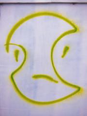 He's the Apple of My Eye (Steve Taylor (Photography)) Tags: apple minimalist minimalism streetart green white wood plywood newzealand nz southisland canterbury christchurch cbd city curve face sad