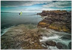 Windsurfer (Hugh Stanton) Tags: rocks tide shore surf
