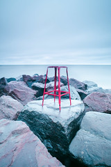 There's gotta be a better way to get outta here~ (Ernie Kwong Photography) Tags: seascape sea autumn coastal waterfront waterscape lakeontario lake toronto torontonist torontolife nikon rocks stool red longexposure poselongue emptiness conceptual