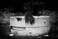 Coming out of the well (Kilkennycat) Tags: portrait blackandwhite bw canon children child 50mm14 creepy well spooky wicked thering sadako samara 500d kilkennycat t1i ryanconners