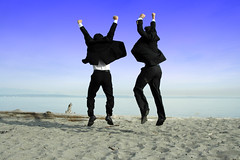 Two businessmen jumping and celebrating on the beach (Ibiza Inside) Tags: ocean blue friends sea people man male men beach water businessman work asian happy corporate office team jump hands commerce friendship outdoor sale unitedstatesofamerica honor meeting communication celebration business company growth achievement together trust deal colleagues contract success celebrate colleague partnership meet negotiation introducing partners teamwork pact honour businessmen businesspeople agreement executives successful businessteam businessgroup