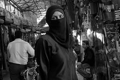Syria - Aleppo (luca marella) Tags: portrait bw woman white black eye beauty look blackwhite market middleeast pb bn souk sight niqab glance bianco nero siria suk trave marellaluca