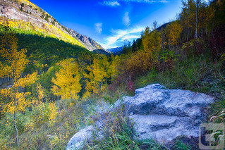 Fall colors fill the valley surrounding the Booth Falls Trail on a warm Autumn morning - Vail, CO