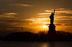 Liberty Sunrise (Dalliance with Light (Andy Farmer)) Tags: nyc sky sun silhouette sunrise liberty dawn newjersey jerseycity unitedstates nj statueofliberty ladyliberty