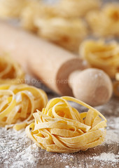 Homemade pasta (Oxana Denezhkina) Tags: italy food white cooking kitchen yellow closeup dinner recipe table cuisine wooden healthy italian mediterranean raw pin dough background wheat traditional egg culture tasty pasta fresh gourmet homemade meal noodles spaghetti flour making rolling preparation linguine tagliatelle preparing ingredient uncooked