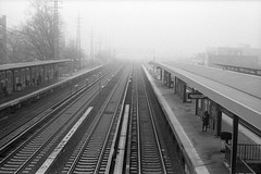 (Rafakoy) Tags: camera railroad blackandwhite bw newyork film rain station weather fog analog train 35mm season mood cloudy manhattan tracks atmosphere overcast queens rainy woodside nik