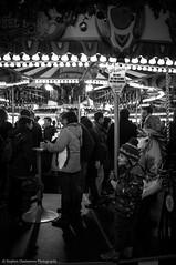 Drinks on the Carousel (Stephen Champness) Tags: people blackandwhite black london blackwhite fuji drink candid carousel winterwonderland fujix100