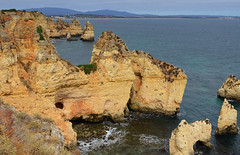 View of The Algarve (rschnaible) Tags: ocean red sea orange cliff seascape color portugal rock landscape coast sandstone colorful cliffs lagos atlantic coastal geology algarve rugged the geologic