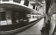 Oxford Circus - Naturally Different. (Pete37038) Tags: uk greatbritain travel england blackandwhite london english monochrome speed train underground subway mono movement nikon europe britain capital tube retro fisheye human british londonunderground londontube passenger blacknwhite oxfordcircus highiso humaninterest londontransport londonist capitalcity ruby3 oxfordcircusstation nikond londonundergroundstation nikon105mmfisheye londonphotography ukcapital nikond90 europeancapital londoninteresting londonheritage ruby10 photographymono ruby15 pete37038 londonmonochrome peterowbottom